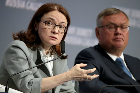 "Russia's Central Bank Governor Elvira Nabiullina (L) and Andrei Kostin, president and chairman of the Management Board at VTB Bank, attend the 7th annual investment forum ""Russia Calling!, Oct. 13. Source: Mikhail Metzel/TASS"