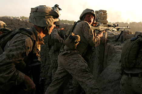 U.S. marines fire during a Taliban ambush as they carry out an operation to clear an area in Helmand province, October 9, 2009. Source: Reuters