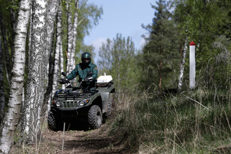 Latvian border guard Arturs Lazarevs drives a quad during a patrol at the EU external border with Russia near Opoli. Source: Reuters