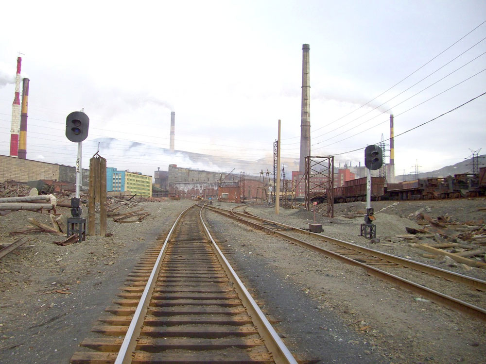 But in 1998 the passenger trains were cancelled as Norilsk mining company considered them loss-making. //Thermal power station outside Norilsk