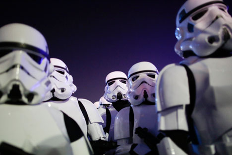 "People dressed as Stormtroopers parade during a campaign of the Star Wars ""The Force Awakens"" film at the Rock in Rio music festival in Rio de Janeiro, Brazil, Sept. 19, 2015. Source: AP"