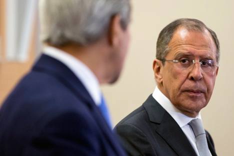 Russian Foreign Secretary Sergey Lavrov looks at U.S. Secretary of State John Kerry.