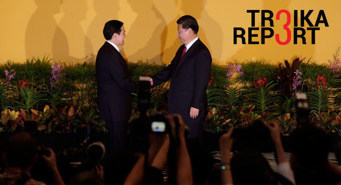 Chinese President Xi Jinping (R) and Taiwanese President Ma Ying-Jeou shake hands at the Shangri-La Hotel in Singapore, Nov. 7, 2015