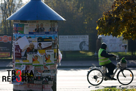 An advertising pillar covered with election posters is seen in Radzymin near Warsaw, Poland, Oct. 27, 2015.