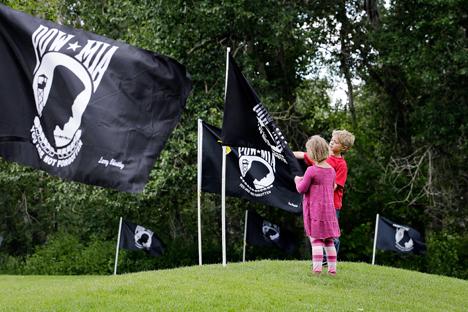 Children look at a POW-MIA flag, Hailey, Idaho, June 21, 2013.