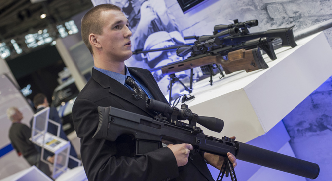 "A staffer holds a silent anti-materiel rifle ""Vykhlop"" presented on the stand of Rostech companyat the International Exhibition of Homeland Security Interpolitex 2015."