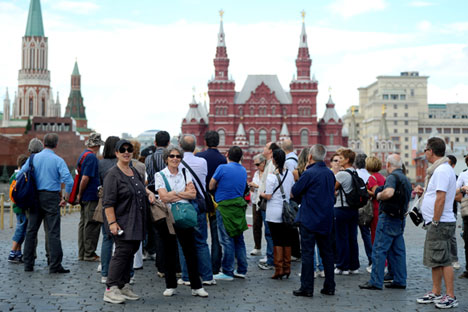 Tourists take pictures of the State Historical Museum in Moscow's Red Square.