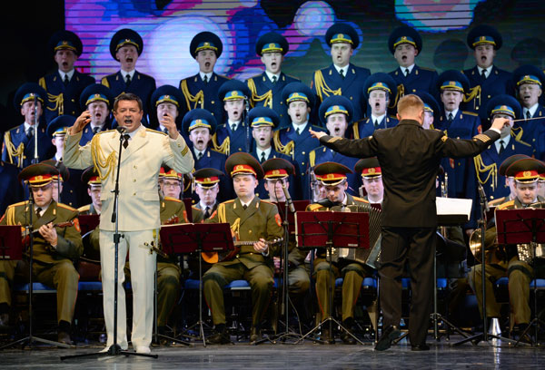 Members of the Alexandrov Russian Army song and dance ensemble perform at the VII International Winter Festival Arts, part of the cultural program at the XXII Olympic Winter Games in Sochi. Left: soloist Vladimir Ananev.