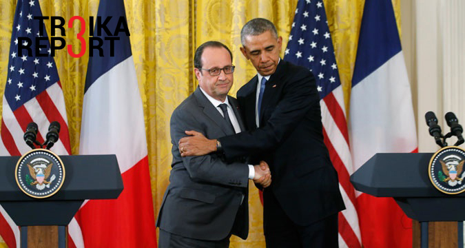 U.S. President Barack Obama (R) greets French President Francois Hollande during a joint news conference in the East Room of the White House in Washington, Nov. 24, 2015