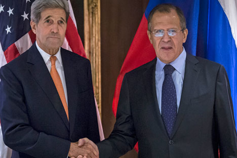 U.S. Secretary of State John Kerry and Russian Foreign Minister Sergey Lavrov shake hands during a photo opportunity but without speaking to reporters, in Vienna, Austria, Oct. 23, 2015.