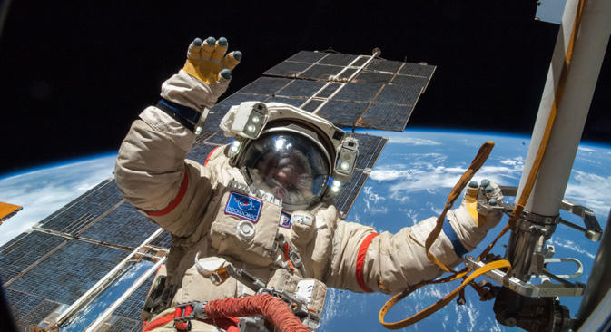 A Russian cosmonaut floats free from politics outside the International Space Station.