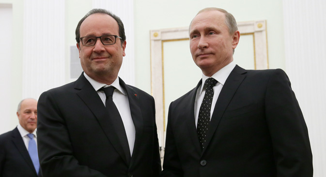 Francois Hollande and Vladimir Putin shake hands during a meeting in Moscow's Kremlin.