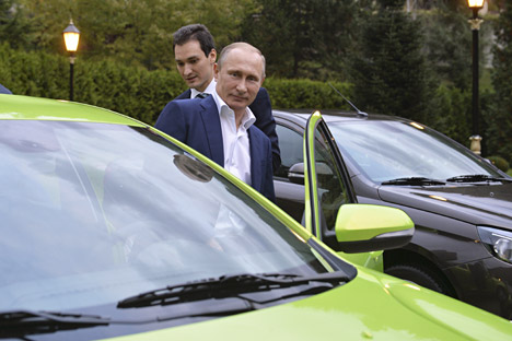 Russian President Vladimir Putin gets into an AvtoVAZ Lada Vesta before driving to attend a session of the Valdai International Discussion Club in Sochi, Oct. 22, 2015