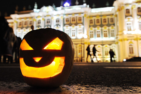 Halloween pumpkin head on Palace Square in St. Petersburg