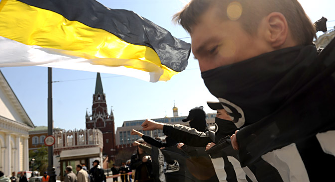 Masked demonstrator takes part in the march organised by the Movement against Illegal Immigration in central Moscow.