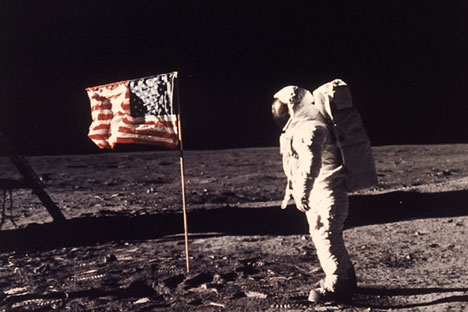 "In this July 20, 1969 file photo, astronaut Edwin E. ""Buzz"" Aldrin Jr. stands next to a U.S. flag planted on the moon during the Apollo 11 mission."