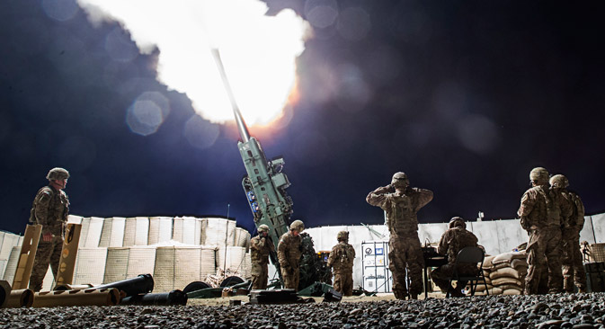 U.S. soldiers from the 3rd Cavalry Regiment take part in an artillery exercise on forward operating base Gamberi in the Laghman province of Afghanistan December 24, 2014