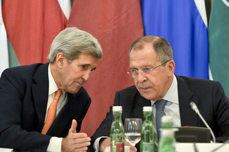 US Secretary of State John Kerry and Russian Foreign Minister Sergei Lavrov speak with each other during an international conference on Syria at the Hotel Imperial in Vienna, Austria, Oct. 30, 2015.