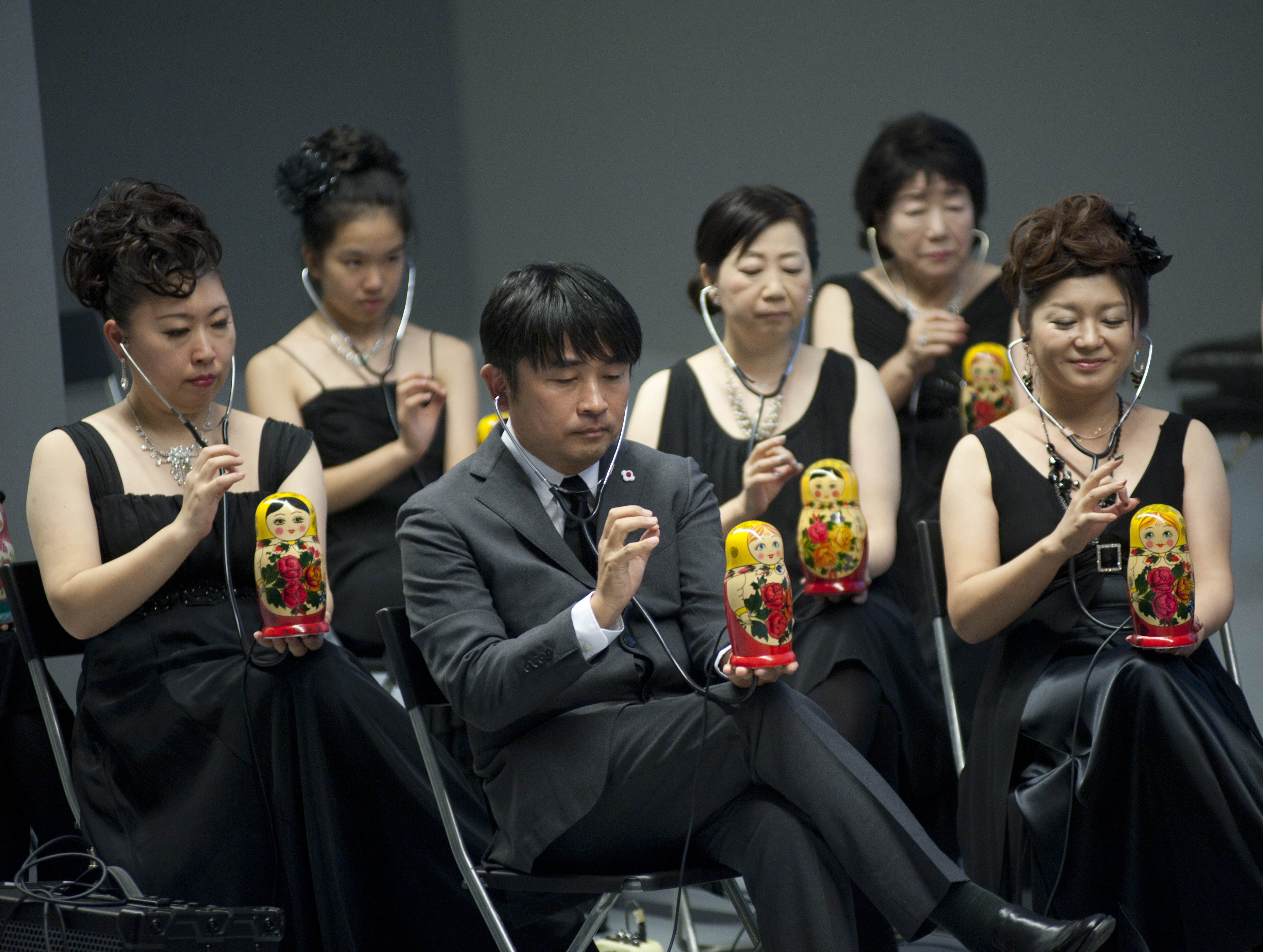 A Japanese orchestra under the direction of Masami Takeuchi (in the middle). Source: Press Photo