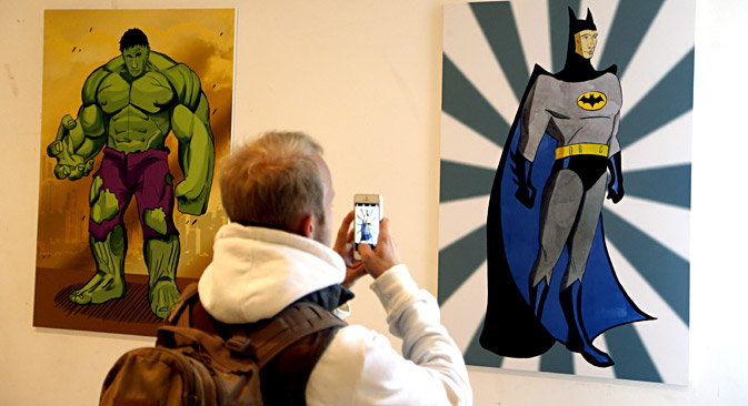 Vladimir Putin as comicbook characters 'The Incredible Hulk' (L) and as Gotham City super-hero protector 'Batman' (R). Source: EPA