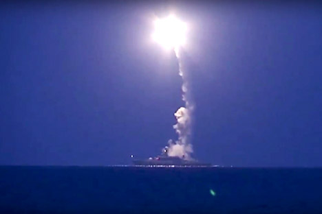 In this photo made from the footage taken from Russian Defense Ministry official web site, Oct. 7, 2015, a Russian navy ship launches a cruise missile in the Caspian Sea.