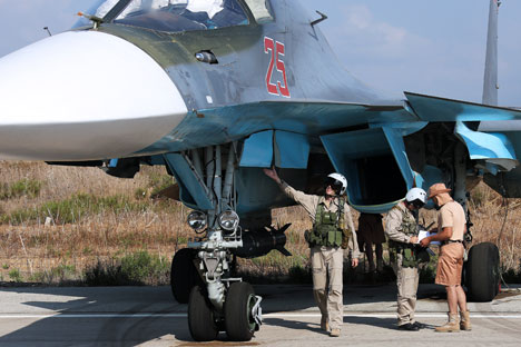 LATAKIA, SYRIA. OCTOBER 4, 2015. Pilots of Russia's Sukhoi Su-34 fighter jet at the Hmeymim airbase.