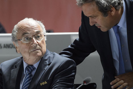 Sepp Blatter (L) and Michel Platini.