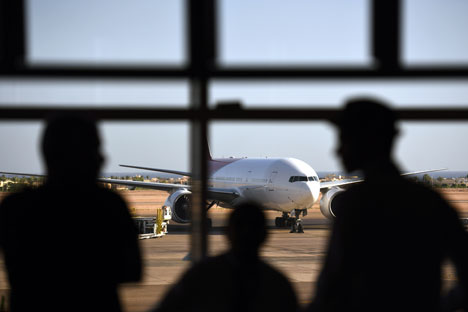 Tourists look out at a Russian plane on the tarmac of the airport in Egypt's Red Sea resort of Sharm el-Sheikh on Nov. 6, 2015.