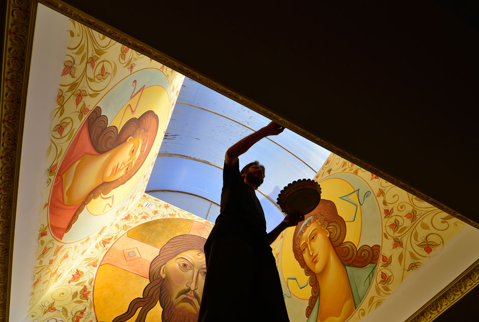 An icon painter decorates one of the walls of the hall of the Primorsky Center of regenerative medicine and rehabilitation, Vladivostok, Russia, Nov. 9, 2015.
