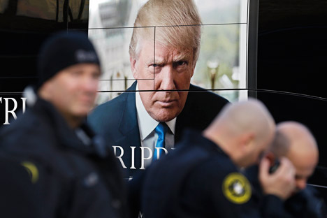 Police gather in front of Donald Trump's bus outside of the Milwaukee Theatre before a Republican presidential debate Tuesday, Nov. 10, 2015, in Milwaukee.