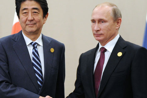 Japanese Prime Minister Shinzo Abe, left, shakes hands with Russian President Vladimir Putin prior to their talks during the G-20 Summit in Antalya, Turkey, Nov. 16, 2015.