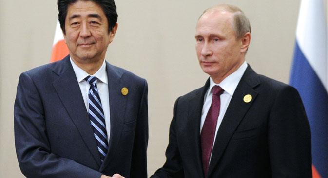 Japanese Prime Minister Shinzo Abe, left, shakes hands with Russian President Vladimir Putin prior to their talks during the G-20 Summit in Antalya, Turkey, Monday, Nov. 16, 2015.