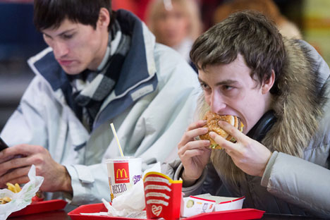 Russians eat in a McDonald's restaurant.