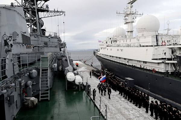 "Naval servicemen giving a welcome to the state-of-the-art reconnaissance ship (Project 18280) ""Yury Ivanov"" on its arrival at its permanent base in Severomorsk."