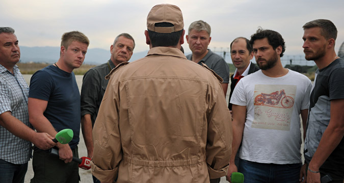 Rescued pilot of the Russian Air Force's Su-24 jet, Captain Konstantin Murakhtin, center, answers journalists' questions at Khmeimim Air Base in Latakia.