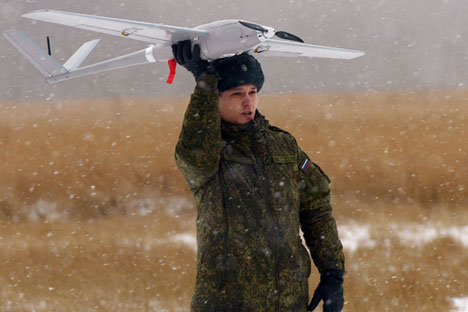 A cadet of the Defence Ministry's State Center of Unmanned Aviation during the launch of the Orlan-10 unmanned aerial vehicle at a training field in the Moscow Region.