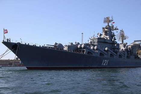 "The flagship of the Russian Black Sea Fleet missile cruiser of the Guards ""Moscow"" in Sevastopol Bay."