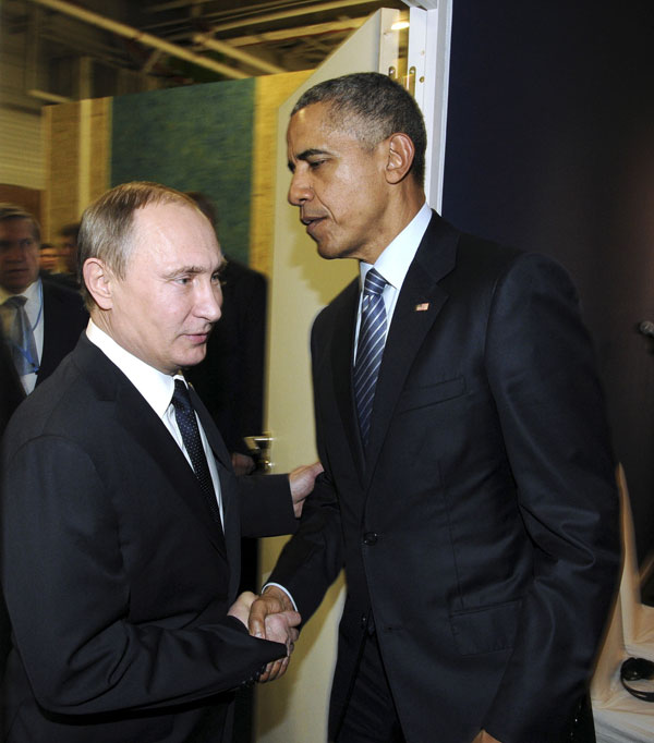 Russian President Vladimir Putin shakes hands with U.S. President Barack Obama as they meet during the World Climate Change Conference 2015 (COP21) at Le Bourget, near Paris, France, Nov. 30, 2015.