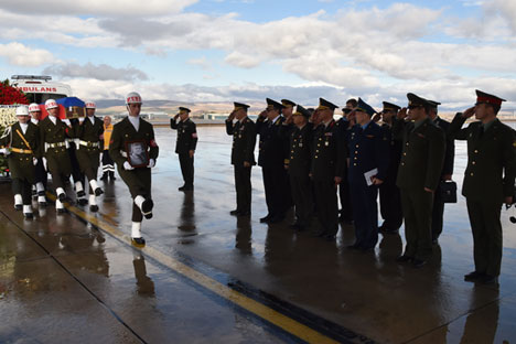 Members of a Turkish honor guard carrying the coffin of the Russian pilot who killed in the downing of a fighter jet in Syria, at Ankara airport, in Ankara, Turkey, November 30, 2015.