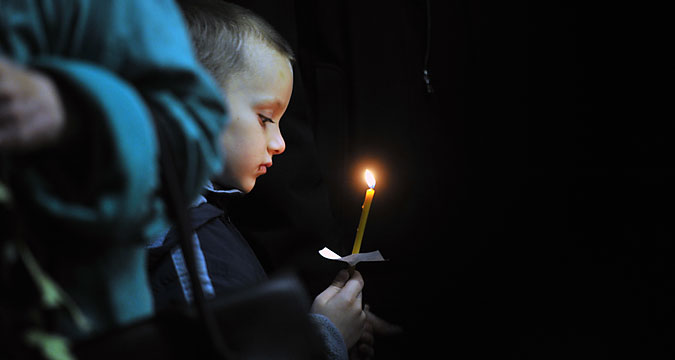 A boy at a funeral service for a victim of the A321 crash, at a church in Veliky Novgorod. Some of the victims have yet to be identified and buried.