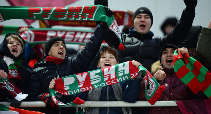 Rubin's fans celebrate a goal during the Russian Football Premier League championship's 14th round match between football clubs Ural Yekaterinburg and Rubin Kazan.