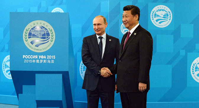 Russian President Vladimir Putin, left, and Chinese President Xi Jinping ahead of the Shanghai Cooperation Organization (SCO) summit in Ufa, Russia, July 10, 2015.