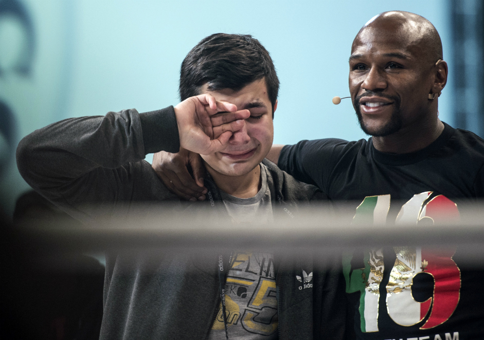 Floyd Mayweather, right, during open training session in Moscow at the Rossiya State Concert Hall.