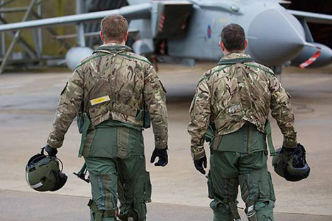 Pilots and ground crew prepare a Tornado at R.A.F. Marham.