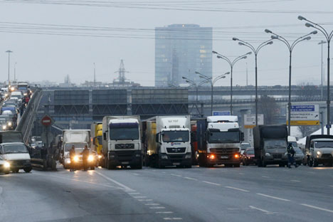 A road police officer blocks off the traffic on the Moscow Ring Automobile Road (MKAD) on the suburbs of Moscow, Russia, December 4, 20