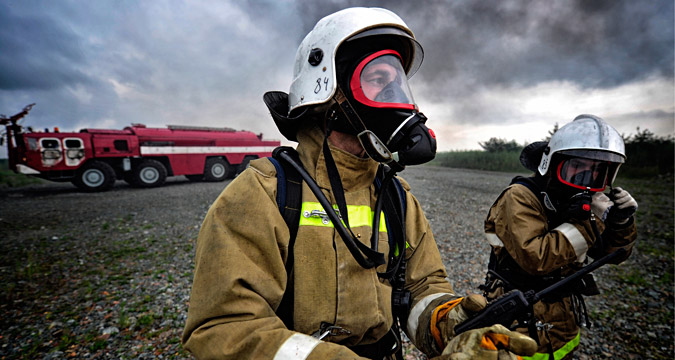 VLADIVOSTOK, RUSSIA. AUGUST 10, 2015. Fire fighters in a routine emergency exercise at Knevichi International Airport.
