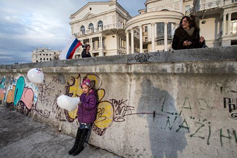 People walking along the enbankment in Sevastopol.