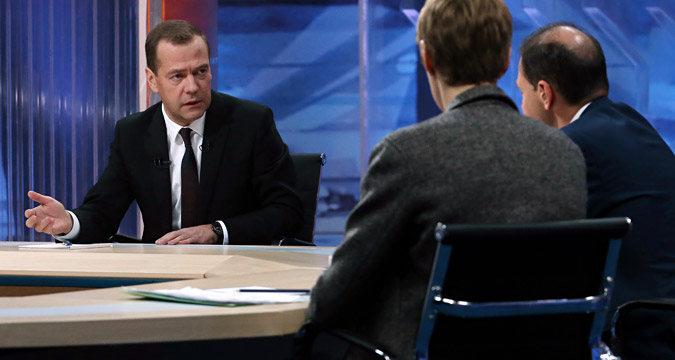 Prime Minister Dmitry Medvedev gives an interview to Russian journalists in a live broadcast, Dec. 9, 2015.