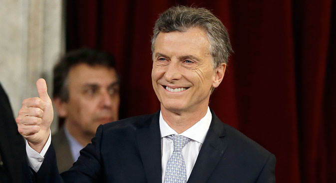 Mauricio Macri gives a thumbs up after being sworn in as new president at the Congress in Buenos Aires, Argentina, Thursday, Dec. 10, 2015. Macri was sworn in, inheriting myriad economic problems from the often divisive outgoing President Cristina Fernandez, who skipped the inauguration in a final sign of defiance that underscored deep polarization in the South American nation.