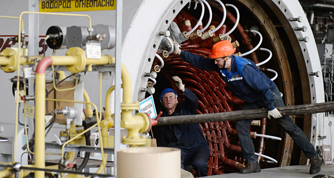 Workers doing maintenance in the turbine hall of Beloyarsk Nuclear Power Plant in Zarechny.